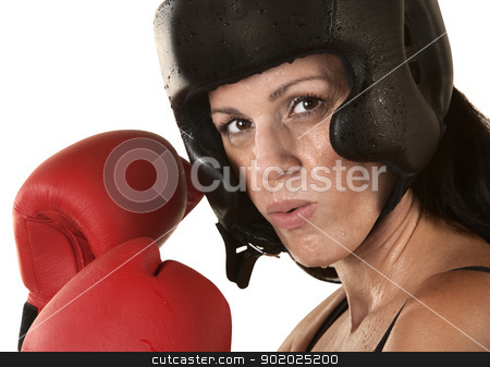 Woman Boxer with Gloves Close Up stock photo, Sweating female adult boxer with gloves up over white by Scott Griessel