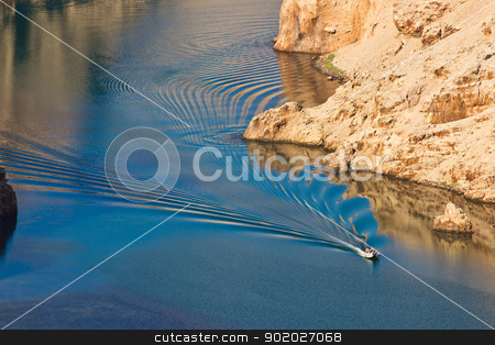 Boat leaving waves in Zrmanja river canyon stock photo, Boat leaving waves in Zrmanja river canyon, Dalmatia, Croatia by xbrchx