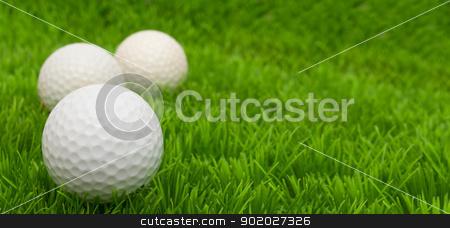 Golf Balls stock photo, Group of Golf Balls in Green Grass  by JAMDesign