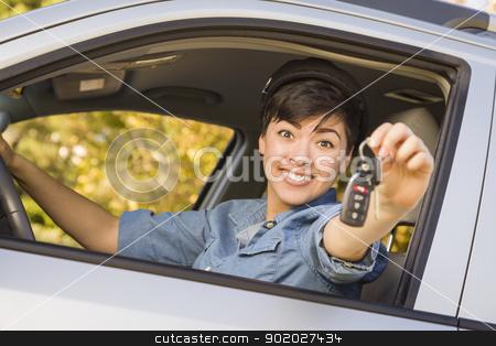 Happy Mixed Race Woman in Car Holding Keys stock photo, Happy Smiling Mixed Race Woman in Car Holding Set of Keys. by Andy Dean