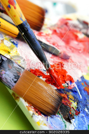 Art palette stock photo, Art palette and brushes with a lot of vivid colors  by Tatiana Mihaliova