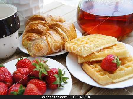 Tasty breakfast - tea, croissants, wafers with cream  stock photo, Tasty breakfast - tea, croissants, wafers with cream and strawberries                   by Tatiana Mihaliova