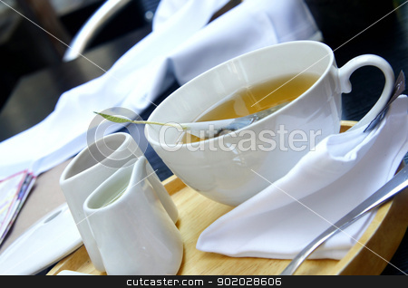 Tea time - green organic tea, white tea service  stock photo, Tea time - green organic tea, white tea service, wooden try, white tablecloth         by Tatiana Mihaliova