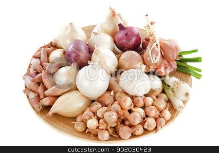 varieties of onions stock photo, group of varieties onions in a wood dish by Bonzami Emmanuelle