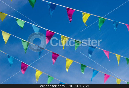 Lots of small color flags and blue sky. stock photo, Lots of small color flags and blue sky. by Stephen Rees