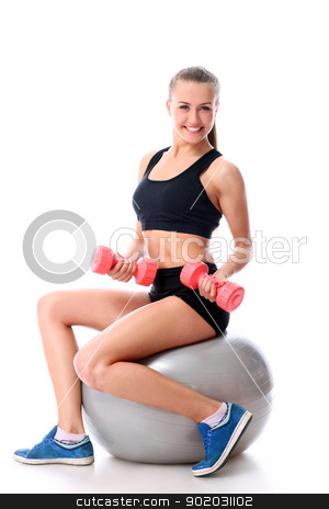 Young woman doing exercise with dumbells on a ball stock photo, Beautiful and smiling woman doing exercises with dumbells on fitness ball over white background by yekostock