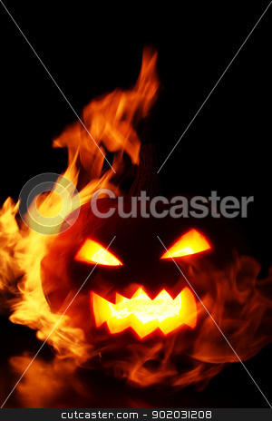 Halloween pumpkin in fire stock photo, halloween pumpkin in fire over a black background by yekostock