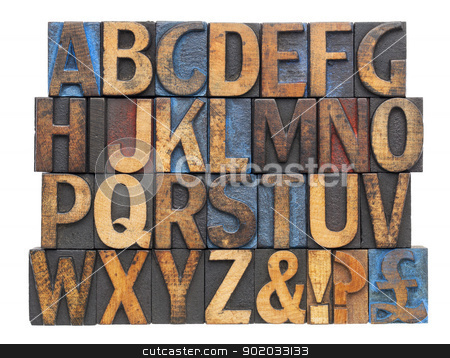 alphabet in antique wood type stock photo, English alphabet with punctuation symbols  in vintage letterpress wood type blocks stained by blue, red and black ink, isolated on white by Marek Uliasz