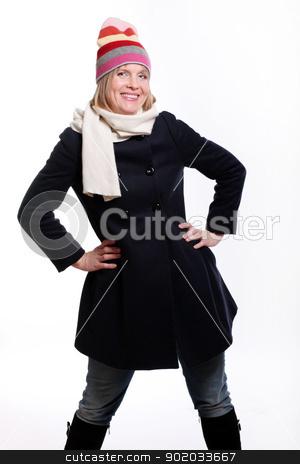 Warm dressed mid age woman stock photo, Warm dressed mid age woman over a white background by yekostock
