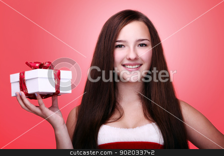 Young and beautiful christmas girl with gift stock photo, Portrait of young and beautiful christmas girl in red with gift by yekostock
