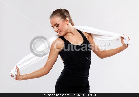 Beautiful brunette with towel stock photo, Beautiful brunette with towel over grey background by yekostock