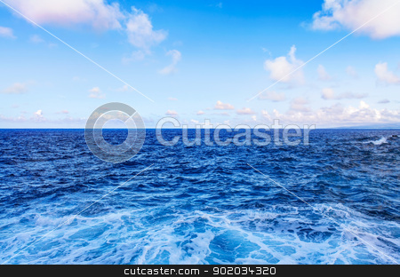 Ocean water waves and blue sky with white clouds. stock photo, Ocean water waves and blue sky with white clouds. by iriana88w
