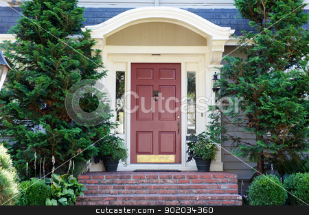Magenta Door Pines stock photo, Magenta Home door bordered by two evergreen pine trees by bobkeenan