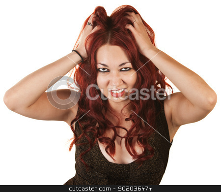 Lady Grabbing Her Hair stock photo, Frowning Latino female on isolated background grabbing her hair by Scott Griessel