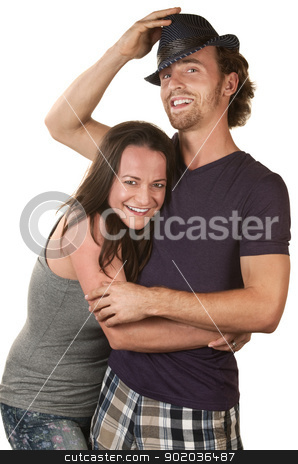 Happy Couple Embracing stock photo, Happy European couple embracing over isolated background by Scott Griessel