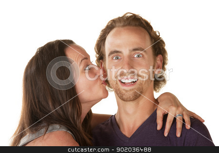 Lady Kisses Excited Man stock photo, Excited young man embraced and kissed by woman by Scott Griessel