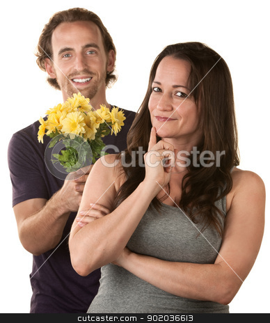 Caucasian Couple Expressing Forgiveness stock photo, Smiling woman and comforting man holding flowers by Scott Griessel