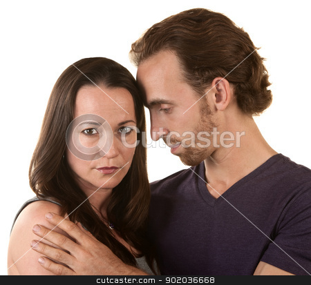 Sad Couple Embracing stock photo, Sad couple embracing over isolated background by Scott Griessel