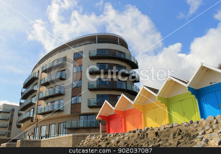 Hotel building and chalets stock photo, Scenic view of colorful chalet buildings with modern hotel in background, Scarborough, England. by Martin Crowdy