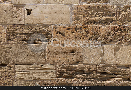 Old stone wall background stock photo, Abstract textured background of old stone wall on building. by Martin Crowdy