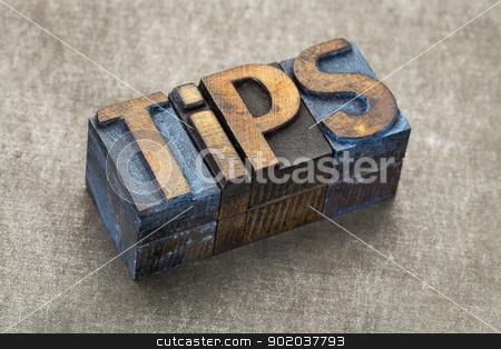 tips word in wood type stock photo, tips word - text in vintage letterpress wood type blocks against a grunge metal background by Marek Uliasz