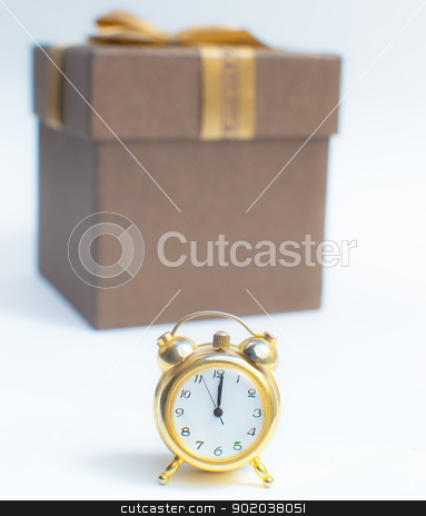 A Happy New Year Clock Striking Midnight with present gift box stock photo, A Happy New Year Clock Striking Midnight with present gift box by vician