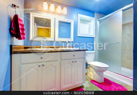 Kids Bathroom with blue walls and pink rug and towel. stock photo, Kids Bathroom with blue walls,  pink rug and towel. by iriana88w