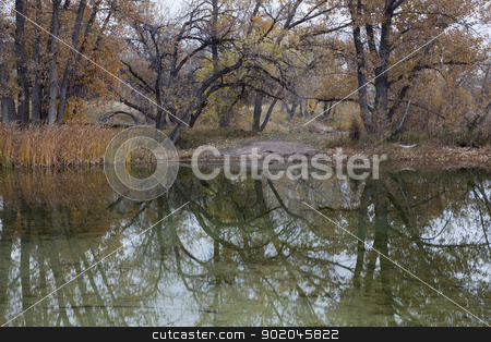 autumn lake reflections stock photo, lake reflections - gravel pit converted into natural area - Riverbend Ponds, Fort Collins, Colorado in late fall scenery by Marek Uliasz