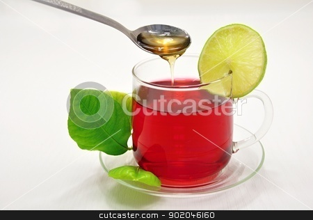 Hot tea stock photo, Glass cup of hot fruit tea with a slice of lemon and honey by Ondrej Vladyka