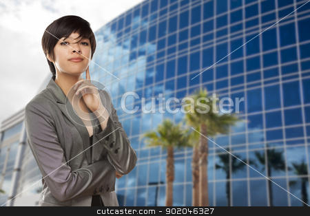 Mixed Race Young Adult in Front of Building stock photo, Attractive Mixed Race Young Adult in Front of Corporate Building. by Andy Dean