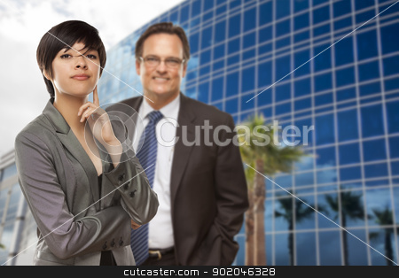 Mixed Race Woman and Businessman in Front of Building stock photo, Attractive Mixed Race Woman and Businessman in Front of Corporate Building. by Andy Dean
