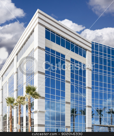 Dramatic Corporate Building Abstract stock photo, Dramatic Reflective Corporate Building with Blue Sky and Clouds. by Andy Dean