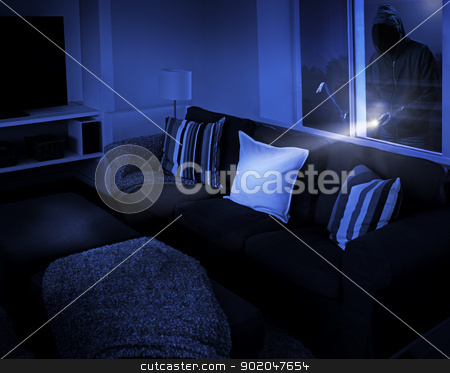 Burglar stock photo, Unrecognizable person with flashlight and crowbar looking through living room window. by Stocksnapper