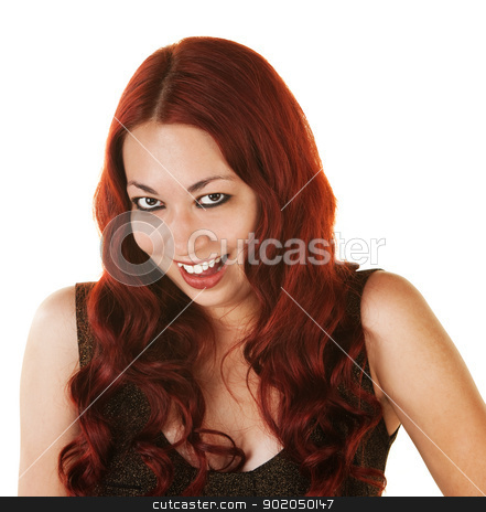 Giggling Hispanic Woman stock photo, Giggling Mexican woman with curly red hair by Scott Griessel