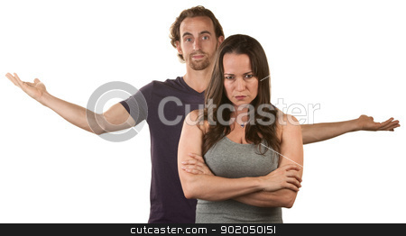 Mad Woman and Frustrated Man stock photo, Frustrated young white couple over isolated background by Scott Griessel