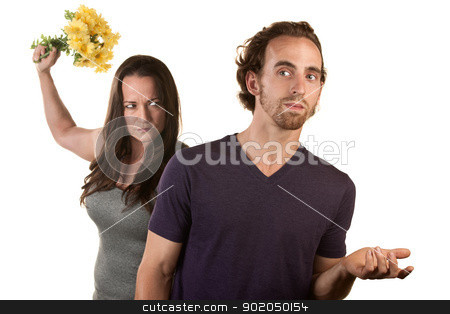 Angry Woman with Flowers and Naive Man stock photo, Woman ready to throw flowers at naive white male by Scott Griessel