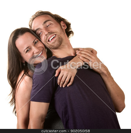 Cute Couple Hugging stock photo, Close up of cute young couple embracing each other by Scott Griessel