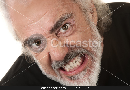 Angry Man Clenches Teeth stock photo, Angry Caucasian senior citizen over isolated background clenching teeth by Scott Griessel