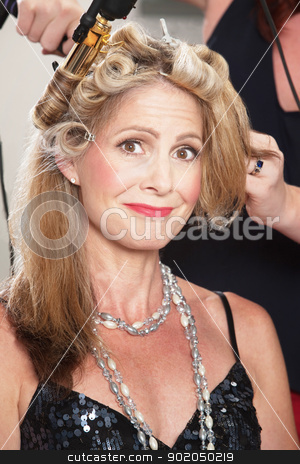 Woman Getting Hair Done stock photo, Smiling woman in beauty parlor getting her hair done by Scott Griessel