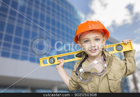 Child Boy Dressed Up as Handyman in Front of Building stock photo, Adorable Child Boy Dressed Up as a Handyman in Front of Corporate Building. by Andy Dean