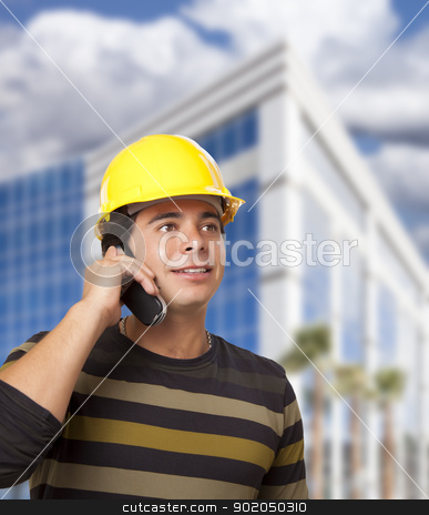 Hispanic Male Contractor on Phone in Front of Building stock photo, Handsome Hispanic Male Contractor on Cell Phone in Front of Corporate Building. by Andy Dean