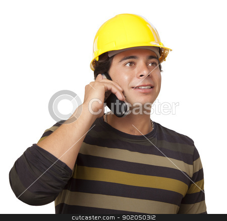 Hispanic Male Contractor in Hard Hat on Phone Isolated stock photo, Handsome Hispanic Hispanic Male Contractor Wearing Hard Hat on Cell Phone Isolated on a White Background. by Andy Dean
