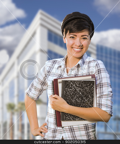 Mixed Race Female Student Holding Books in Front of Building stock photo, Attractive Mixed Race Female Student Holding Books in Front of Building. by Andy Dean