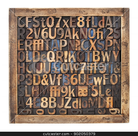 vintage wood type printing blocks stock photo, letters, numbers, punctuation symbols in vintage letterpress wood type blocks placed randomly in a wooden box by Marek Uliasz