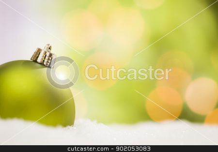 Green Christmas Ornaments on Snow Over an Abstract Background stock photo, Beautiful Matt Green Christmas Ornaments on Snow Flakes Over an Abstract Background with Room For Your Own Text. by Andy Dean