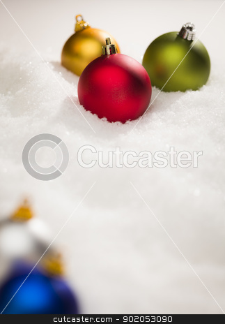 Christmas Ornaments on Snow Flakes with Text Room stock photo, Beautiful Various Colored Christmas Ornaments on Snow Flakes Room For Your Own Text. by Andy Dean