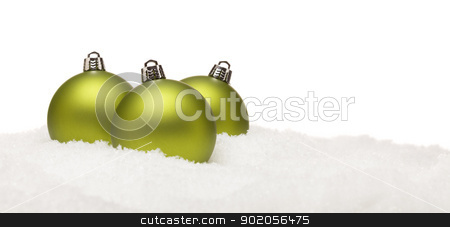Green Christmas Ornaments on Snow Flakes Isolated on White stock photo, Three Green Christmas Ornaments on Snow Flakes on a White Background- Great for a Base Image. by Andy Dean