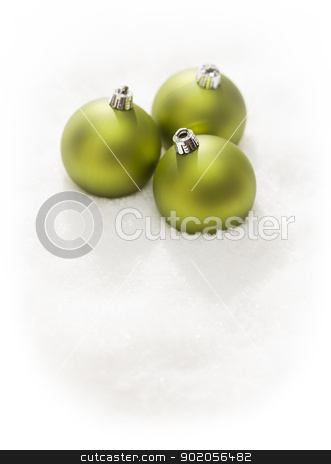 Green Christmas Ornaments on Snow Flakes Isolated on White stock photo, Three Green Christmas Ornaments on Snow Flakes Isolated on a White Background by Andy Dean