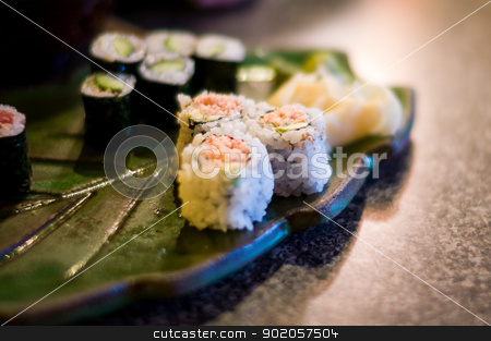 Sushi Rolls stock photo, Japanese Sushi roll on a leaf like ceramic tray by Martin Garcia