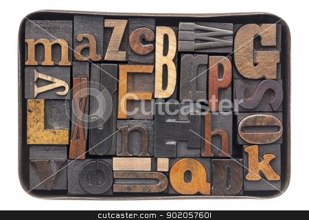vintage wood alphabet in box stock photo, vintage letterpress wood type blocks with ink patina - all 26 letters of alphabet in an old metal box by Marek Uliasz